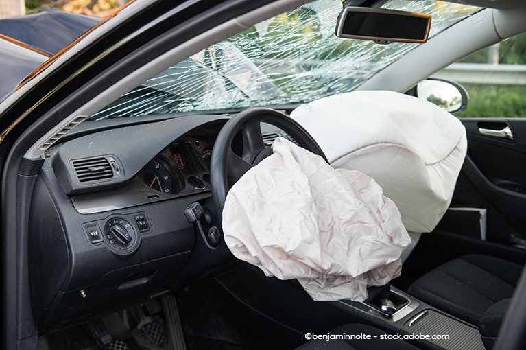 Airbags deploy in the front seats of the car.