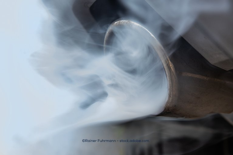White smoke floating out of a tailpipe