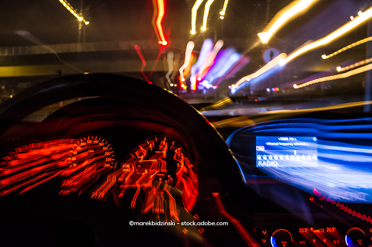 View from the driver's wheel. Lights are blurred to convey speed.