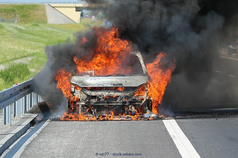 A fire consumes the car
