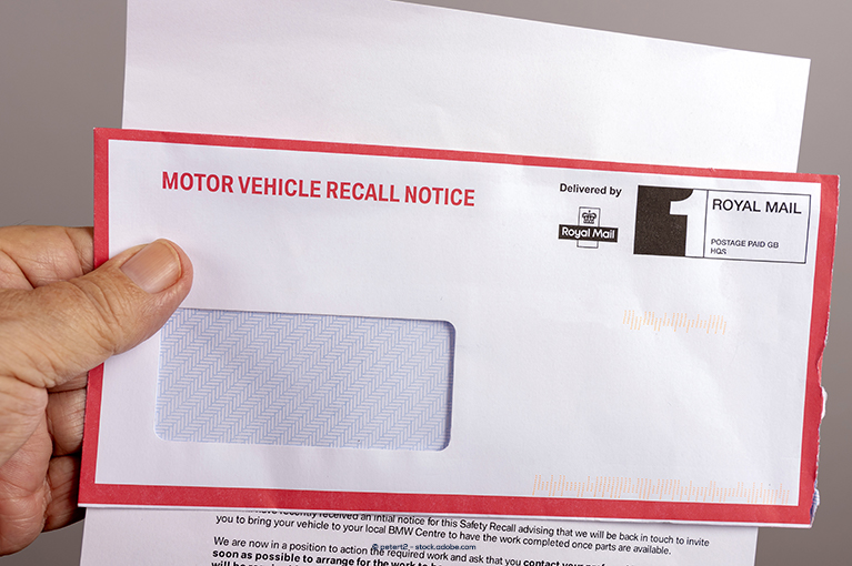 A recall notice has been removed from an envelope