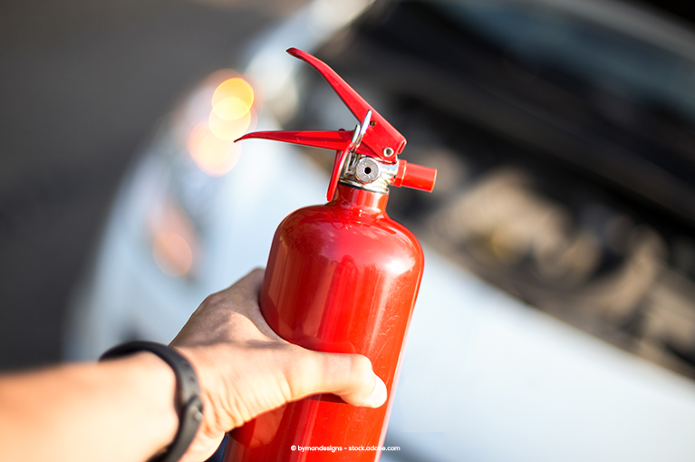 Someone holds a fire extinguisher