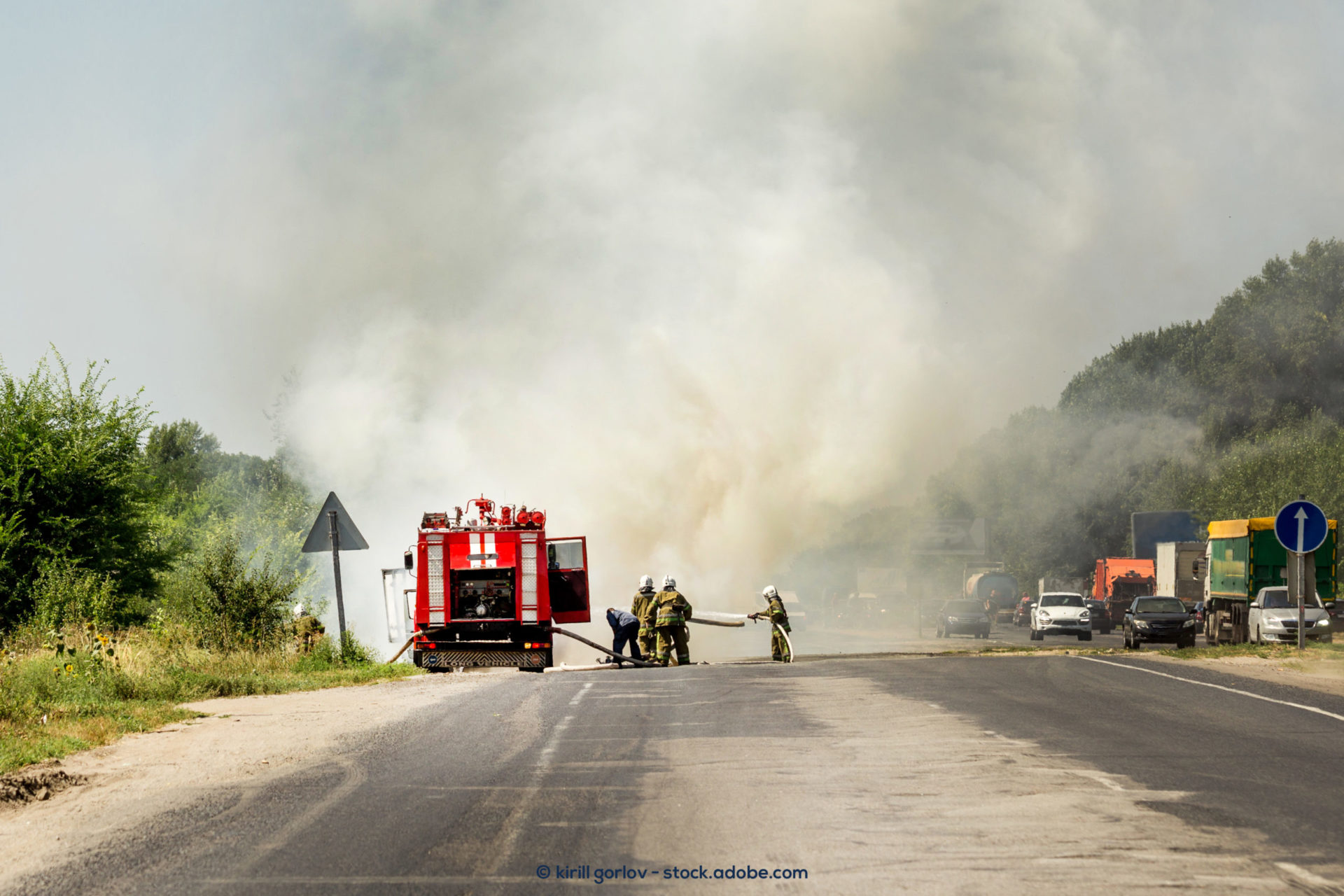Photo description: firefighters with a fire truck.