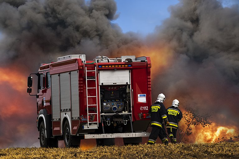 Alt text: A fire truck arrives at the scene of a fire.