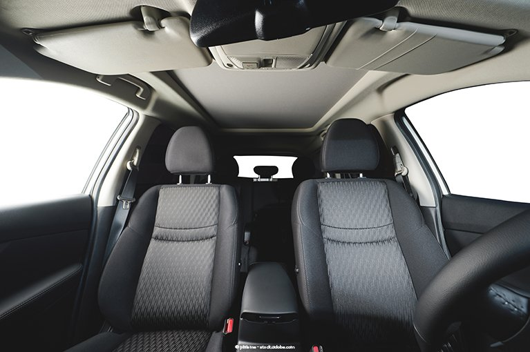Alt text: Two front seats of a vehicle.