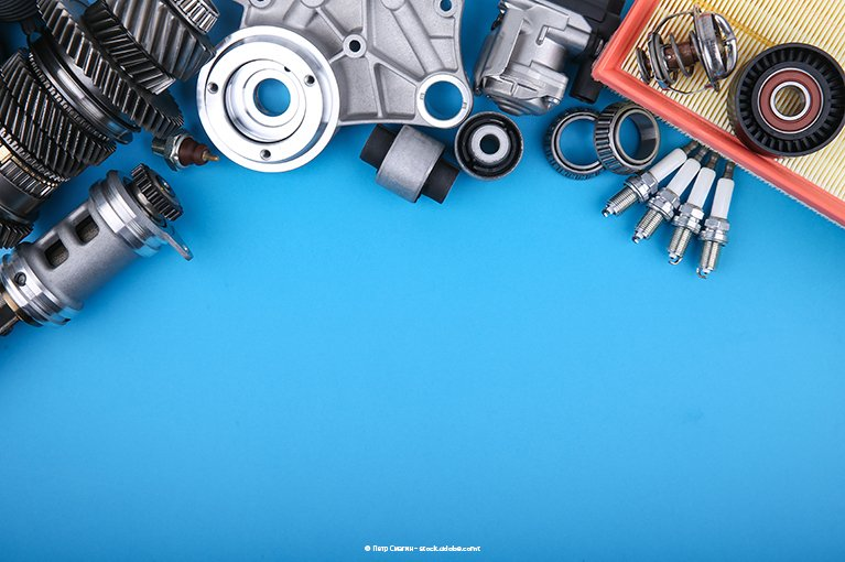 Alt text: Gears are spread apart on a blue background.