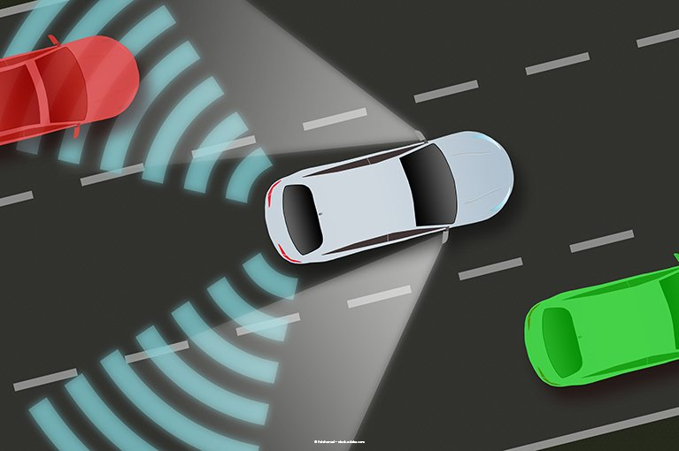 Photo description: A car detects another car in a blind spot.
