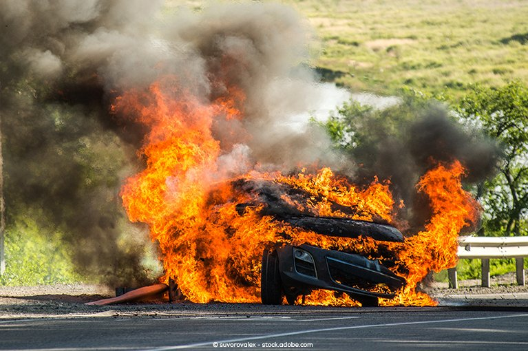 Photo description: A car has been consumed by fire.