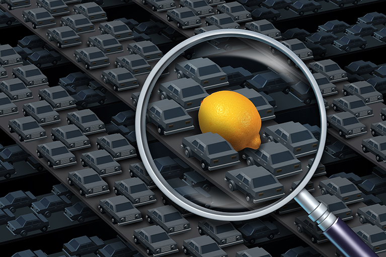 Photo description: A lemon spotted among several vehicles in traffic.