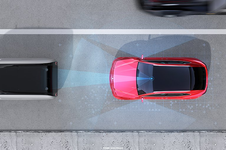 Photo description: A red vehicle's radars detect an obstacle in front of it.
