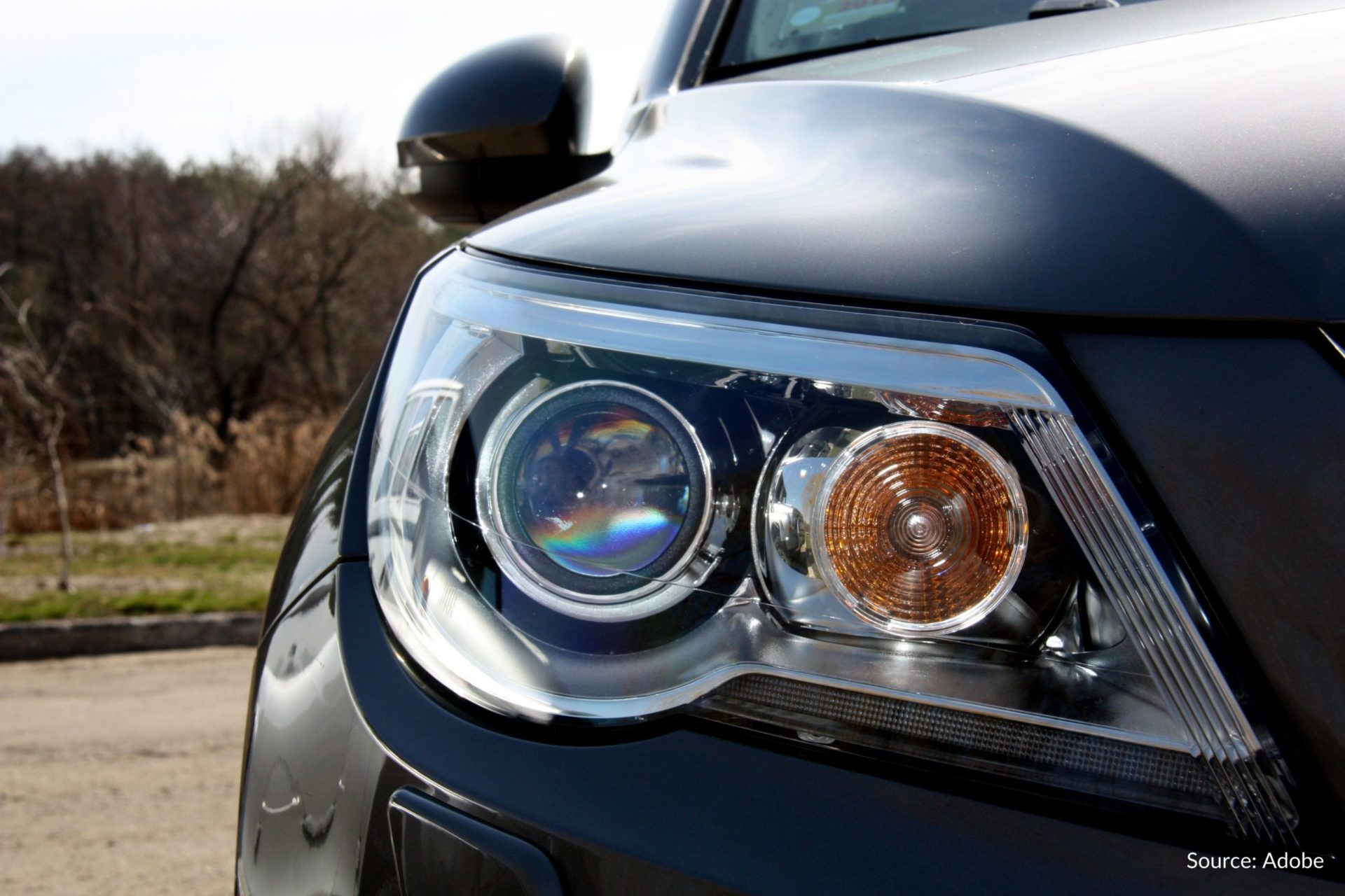 The passenger side headlight of a vehicle.